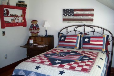 Named For The American Flag Inspired Decorations This Room Includes An  Antique Iron Full Bed Adorned With A Beautiful Old Glory Theme ...